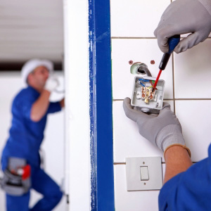 Electricians fixing a power outlet