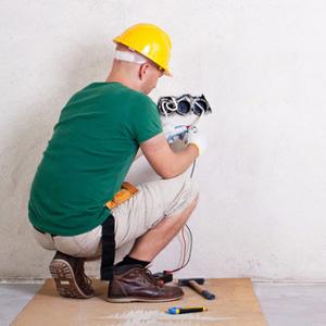 Electrician kneeling