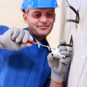 An electrian working on interior wiring