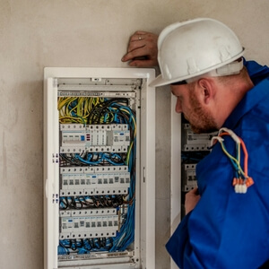 Electrician looking at a circuit breaker